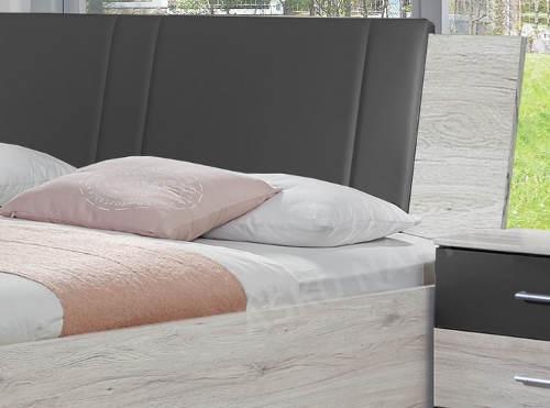 Dvoulůžková postel s čalouněným čelem