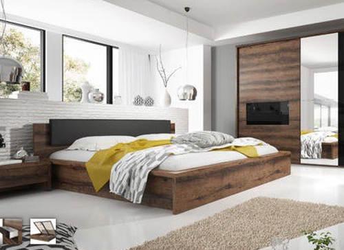 Manželská postel s čelem z černého skla
