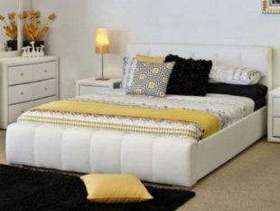 Stylová dvoulůžková postel čalouněná bílou eko kůží