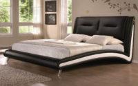 Moderní manželská postel potažená černou ekokůží