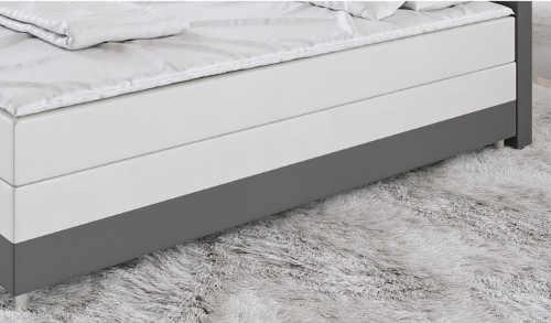 Pohodlná manželská kontinentální postel s vyvýšenou matraci