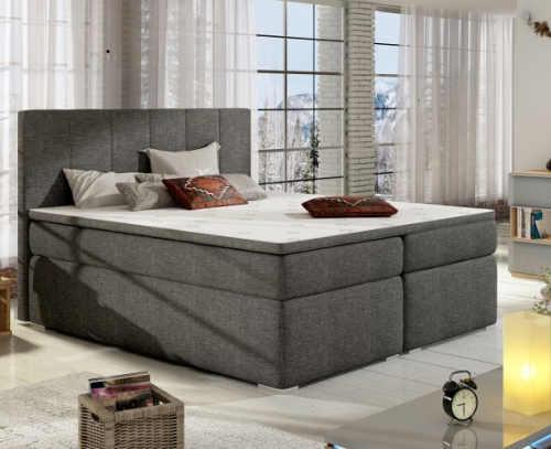 Manželská postel typu boxspring v luxusním designu