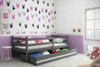 Dětská postel se zábranou a úložným prostorem v provedení grafit/bílá
