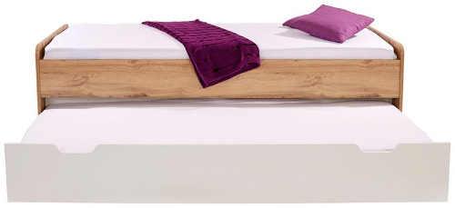 moderní postel skýtající výsuvné lůžko