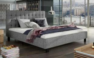 Moderní šedá čalouněná postel s vysokým čelem