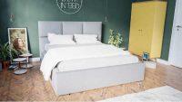 Čalouněná postel v módních barvách s vysokým zadním čelem