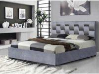 Šedá čalouněná manželská postel s funkcí úložného prostoru